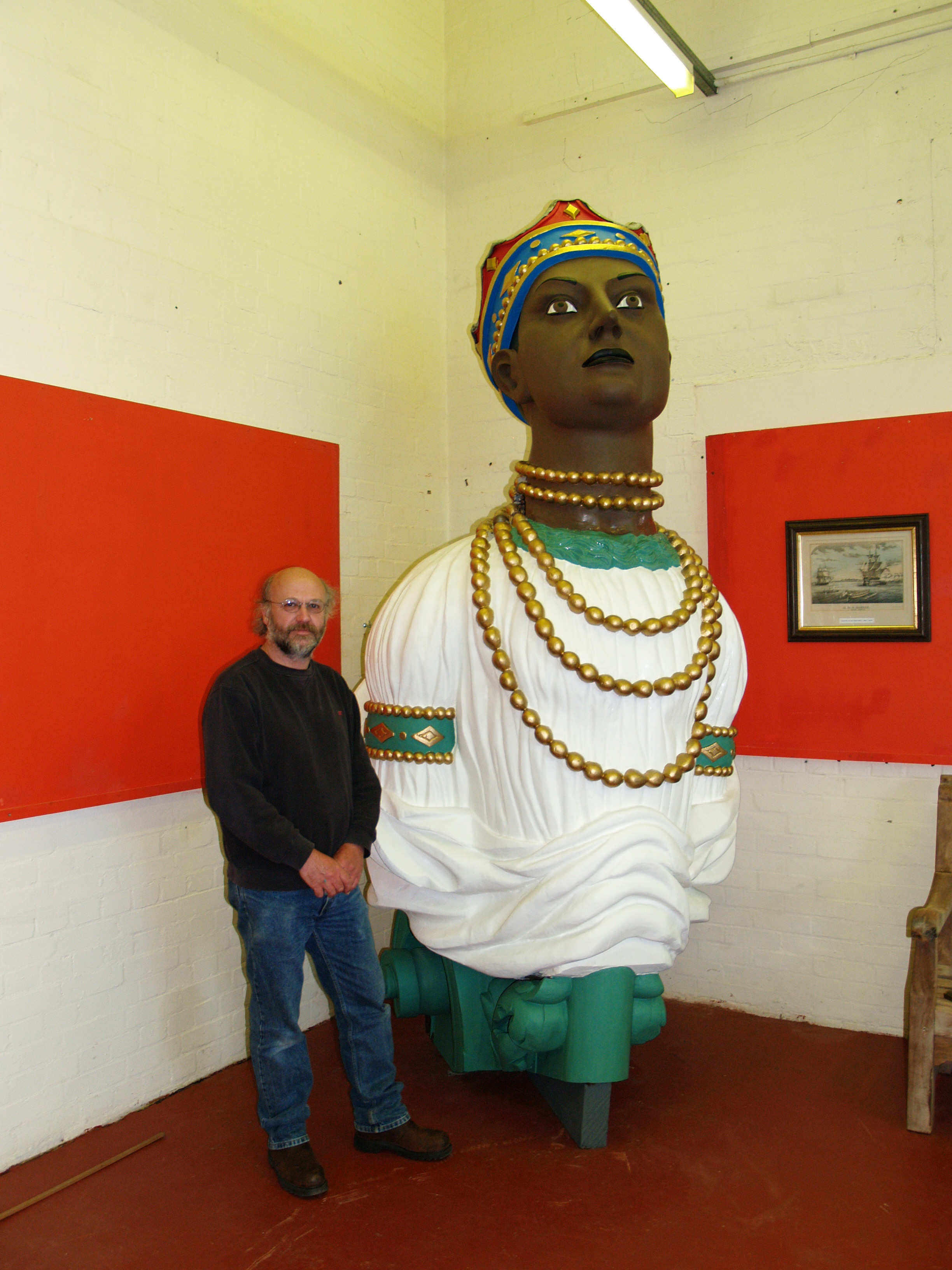 Kelvin standing with his restored ships figurehead